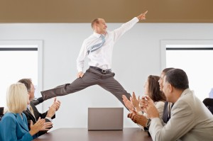 Businessman Midair in a Business Meeting