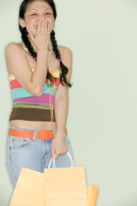 Cheerful Young Woman with Shopping Bags