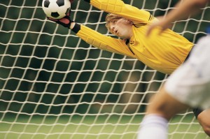 Soccer Goalie Blocking Ball