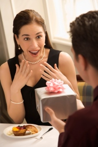 Man giving woman gift.