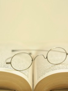 Eyeglasses on Open Book