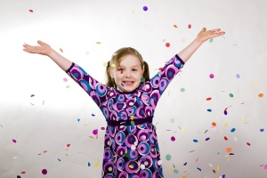 Young girl celebrating with confetti